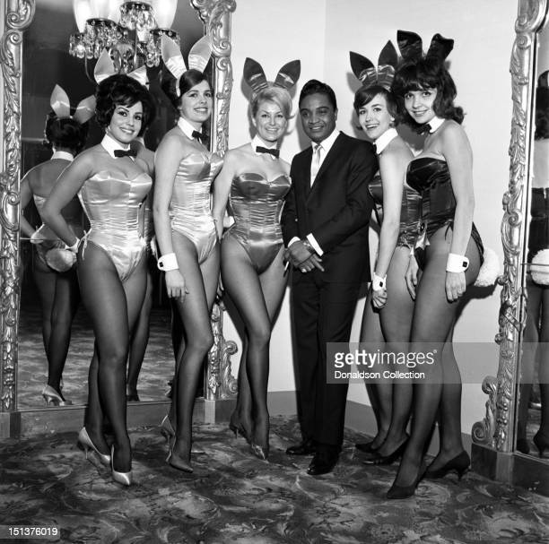 Rock and roll singer Jackie Wilson poses for a portrait with a group of Playboy Bunnies at a dinner for the Motion Picture Pioneers Association at...