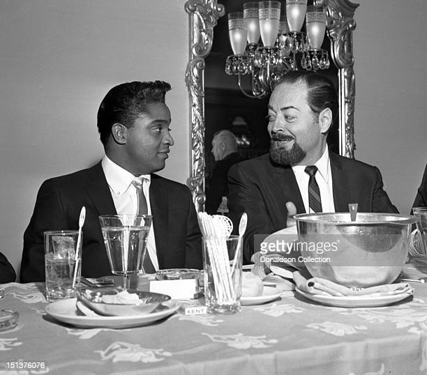 Rock and roll singer Jackie Wilson poses for a portrait with a man at a dinner for the Motion Picture Pioneers Association at the Playboy Club on...