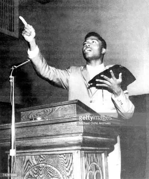 Rock and roll singer Little Richard preaches from the pulpit as he holds the bible after he quit rock and roll in circa 1958 only to return to it in...