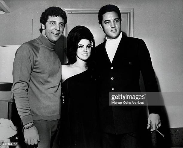 Rock and roll singers Elvis Presley and Tom Jones pose for a portrait with Elvis' wife Priscilla Beaulieu Presley on April 7 1968 in Las Vegas Nevada