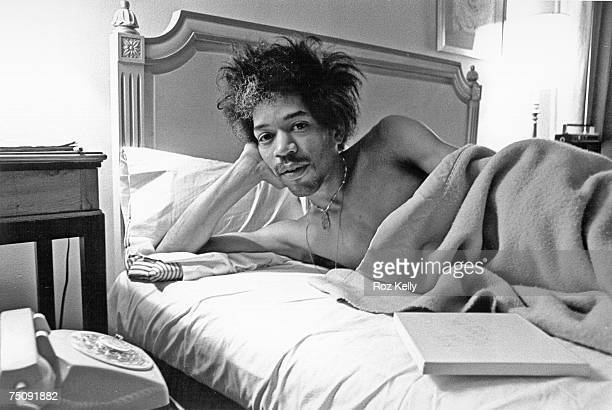 Rock and roll star Jimi Hendrix in bed at the Drake Hotel in New York New York in 1968