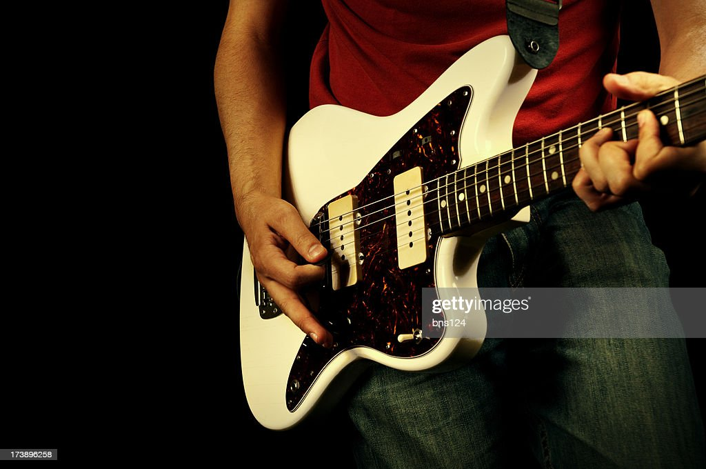 A rock and roll style guitar being played : Stock Photo