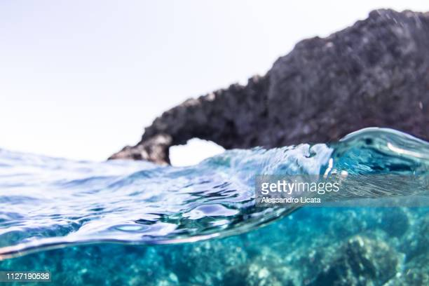 rock arch above the sea of pantelleria in sicily - luogo d'interesse stock pictures, royalty-free photos & images