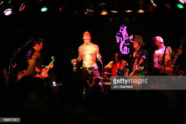 Rock band Buckcherry Keith Nelsonguitar Josh ToddVocals Xavier Murieldrums Jimmy Ashhurstbass Stevie Dguitar opening night of the Confessions tour at...