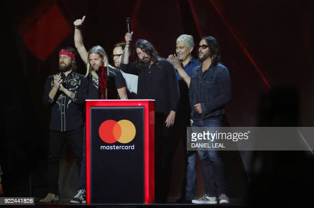 US rock band 'Foo Fighters' Dave Grohl Nate Mendel Pat Smear Taylor Hawkins Chris Shiflett and Rami Jaffee celebrate on stage after receiving the...
