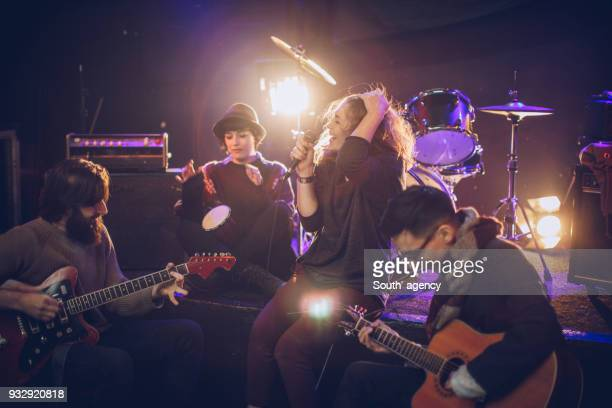 rock band having rehearsal - music style stock pictures, royalty-free photos & images