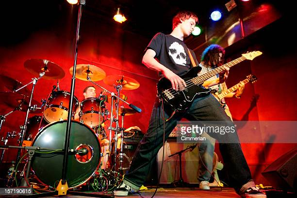 rock band in action - performance group stock pictures, royalty-free photos & images