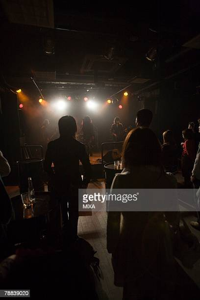 rock band in concert - modern rock stock pictures, royalty-free photos & images