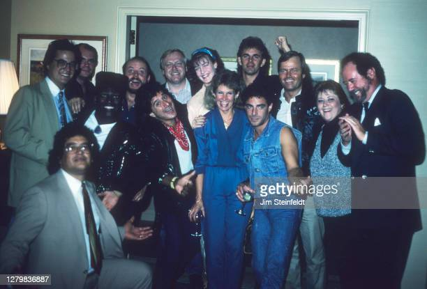 Rock band Journey and crew from Columbia records pose of a photo in Bloomington Minnesota on September 25, 1986.