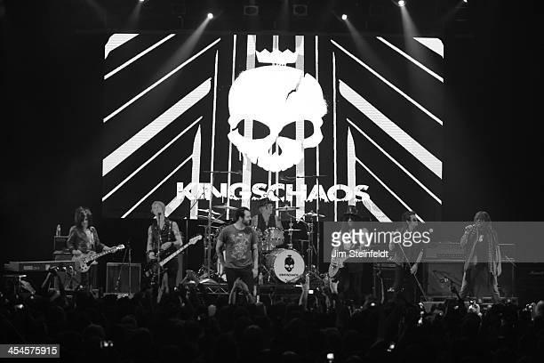 Rock band Kings of Chaos Steve Stevens Duff McKagan Franky Perez Matt Sorum Slash Glenn Hughes and Billy Ray Cyrus perform a benefit concert for Ric...