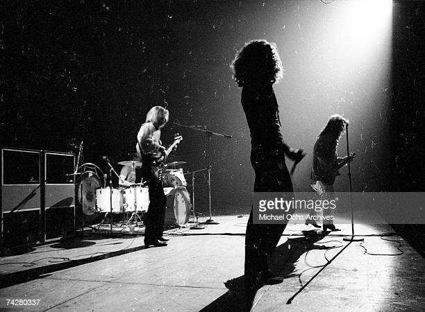 """Rock band """"Led Zeppelin"""" performs onstage in circa 1972. Jimmy Page plays his Gibson Les Paul electric guitar with a bow. John Paul Jones, Robert..."""