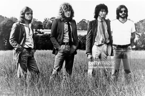 Rock band 'Led Zeppelin' poses for a portrait in a field in 1977 John Paul Jones Robert Plant Jimmy Page John Bonham