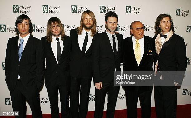 Rock Band Maroon 5 with singer Adam Levine and music executive Clive Davis pose at City of Hope's Spirit of Life Award Gala at the Pacific Design...