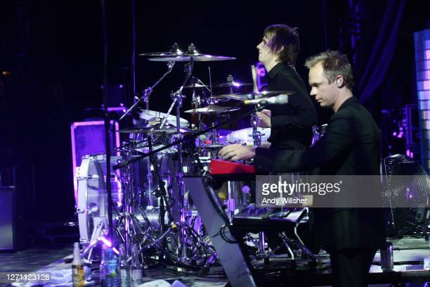 Rock band MUSE, backstage and performing at Reading Festival in 2006