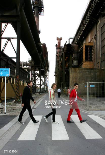 Rock band MUSE photographed impersonate the Abbey Road album cover on a zebra crossing in Luxembourg in 2007
