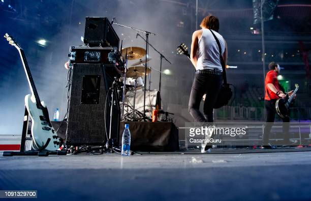 rock band performing on stage - rock band stock photos and pictures
