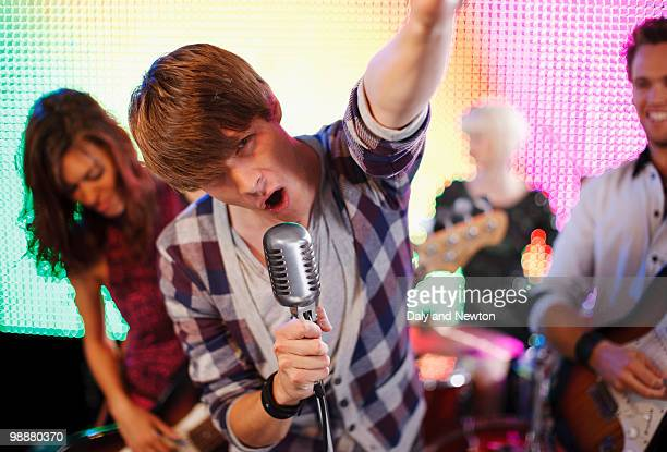 rock band performing on stage - rock music stock pictures, royalty-free photos & images