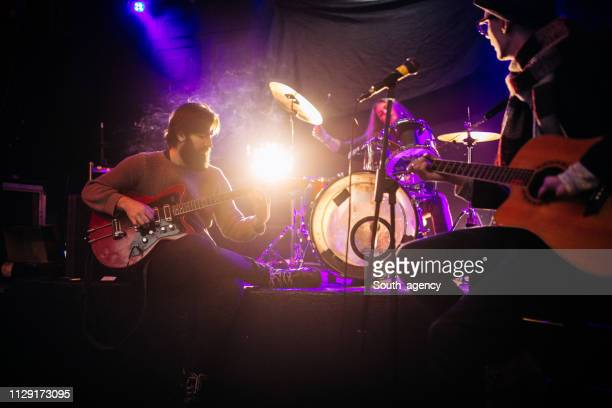 rock band playing at a nightclub - the sounds band stock pictures, royalty-free photos & images
