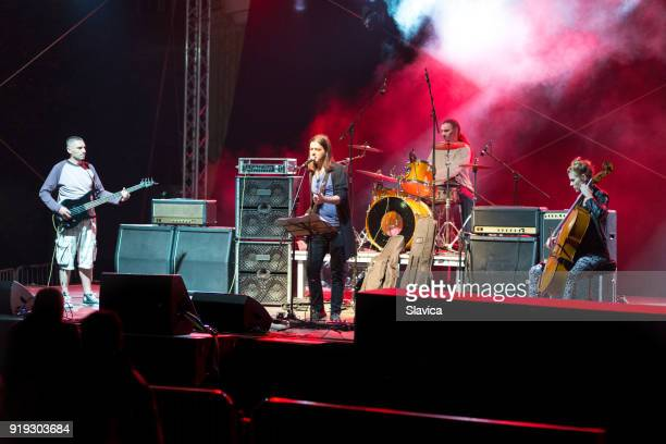 rock band playing on the concert - concert stock pictures, royalty-free photos & images