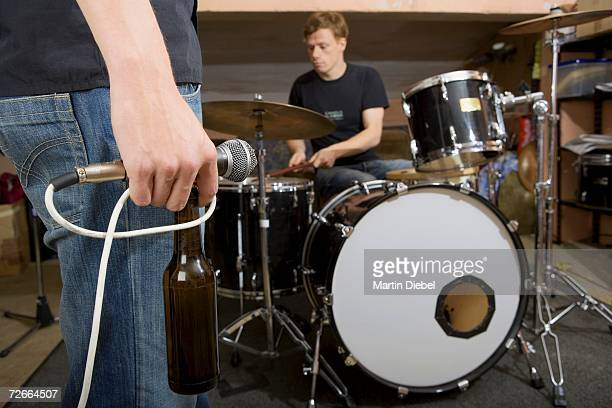Rock band practicing and drinking beer