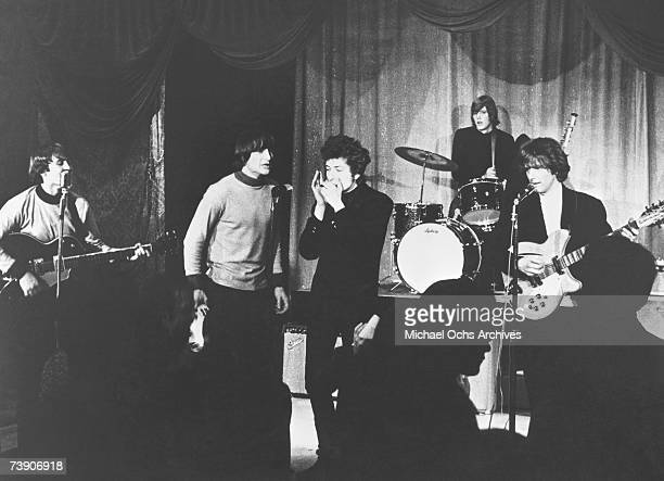 Rock band The Byrds performs onstage at Ciro's Nightclub with Bob Dylan on harmonica in 1965 in Los Angeles California David Crosby Gene Clark Bob...