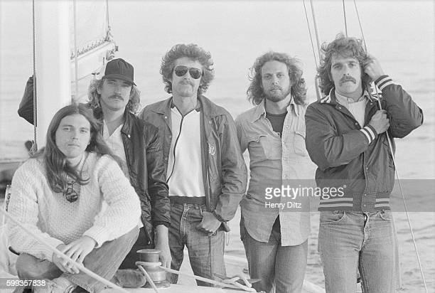 Rock band The Eagles Timothy B Schmit Joe Walsh Don Henley Don Felder and Glenn Frey stand along a mast on a sailboat