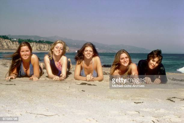 Rock band 'The Runaways' pose for a portrait on the beach in April 1976 in Los Angeles California Lita Ford Cherie Currie Jackie Fox Sandy West and...