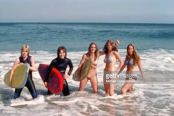 Rock band 'The Runaways' pose for a portrait on the beach in April 1976 in Los Angeles California Cherie Currie Joan Jett Sandy West Jackie Fox and...
