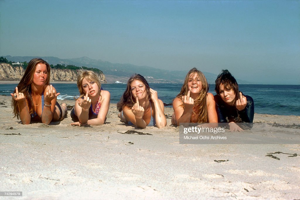 Rock band 'The Runaways' pose for a portrait on the beach in April of 1976. (L-R) Lita Ford, Cherie Currie, Jackie Fox, Sandy West and Joan Jett.