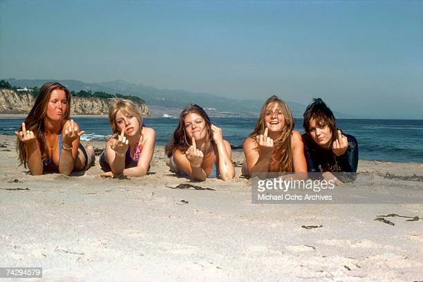 Rock band 'The Runaways' pose for a portrait on the beach in April of 1976 Lita Ford Cherie Currie Jackie Fox Sandy West and Joan Jett