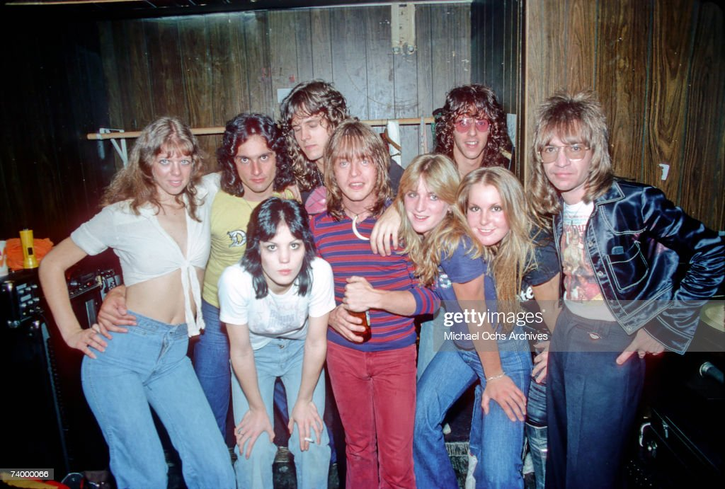 Rock band 'The Runaways' pose for a portrait with musician Rick Derringer and radio DJ Rodney Bingenheimer in September of 1976 in Los Angeles.