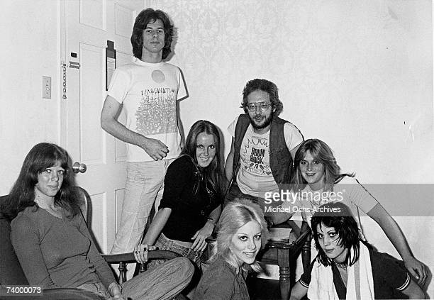 Rock band 'The Runaways' pose for a portrait with some unidentified men Jackie Fox Lita Ford Cherie Currie Sandy West Joan Jett