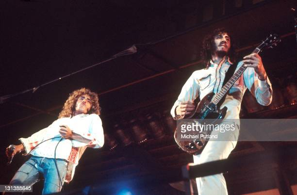 Rock band The Who perform on stage at The Oval cricket ground, London, 18th September 1971. L-R Roger Daltrey, Pete Townshend. Townshend is playing a...
