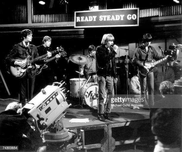 Rock band The Yardbirds perform on the TV show Ready Steady Go on March 4 1966 in London England Drummer Jim McCarty guitarist Chris Dreja guitarist...