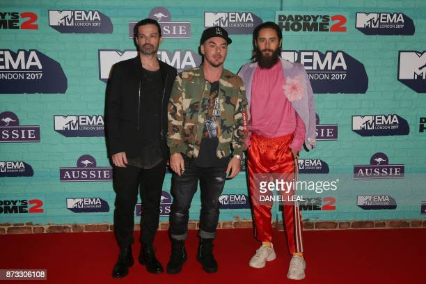 US rock band Thirty Seconds To Mars Jared Leto Shannon Leto and Tomo Milicevic pose on the red carpet arriving to attend the 2017 MTV Europe Music...