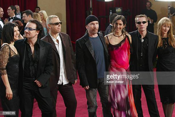 Rock band U2 attend the 75th Annual Academy Awards at the Kodak Theater on March 23 2003 in Hollywood California Bono and wife Alison Stewart Adam...