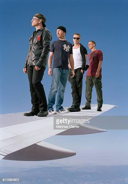 Rock band U2 vocalist Bono lead guitarist The Edge drummer Larry Mullen Jr and bassist Adam Clayton