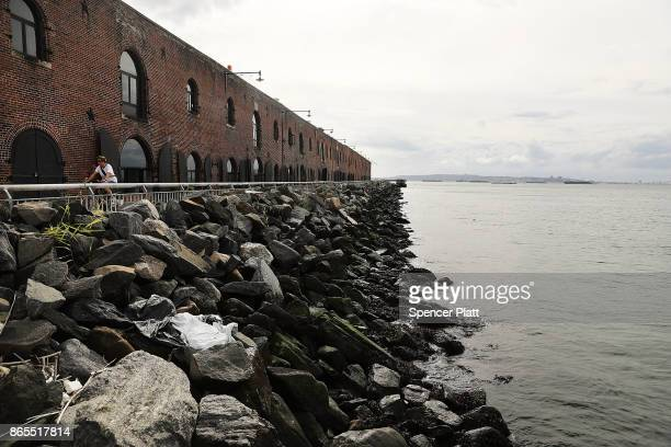 Rock barriers protect a building in Red Hook Brooklyn on October 23 2017 in New York City Red Hook like many coastal neighborhoods in New York was...