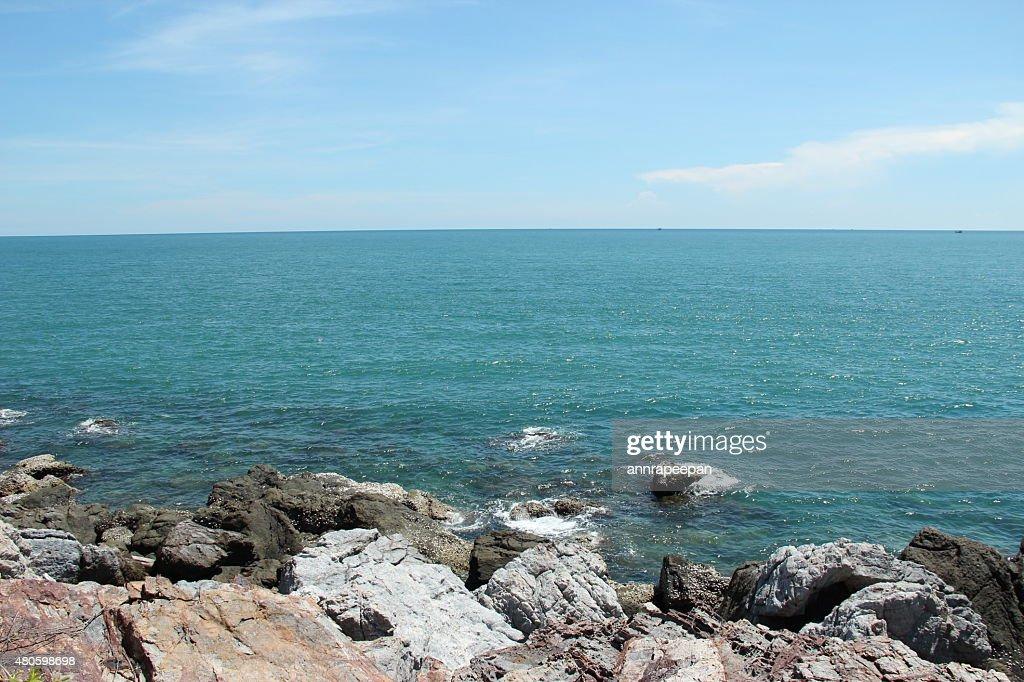 Rock beach and nice blue sea : Stock Photo