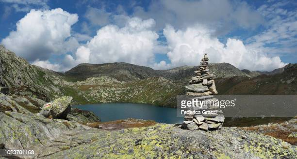 rock cairn at laghi della valletta, gotthard pass - stack rock stock pictures, royalty-free photos & images
