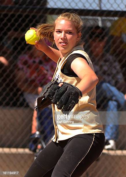 Rock Canyon pitcher Katie Cook fielded the ball and threw to first base in the first inning The Rock Canyon High School softball team beat Erie 51...