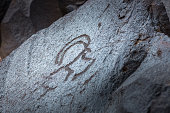 Rock carving of an animal on volcanic stone in Geghama mountains, Armenia.