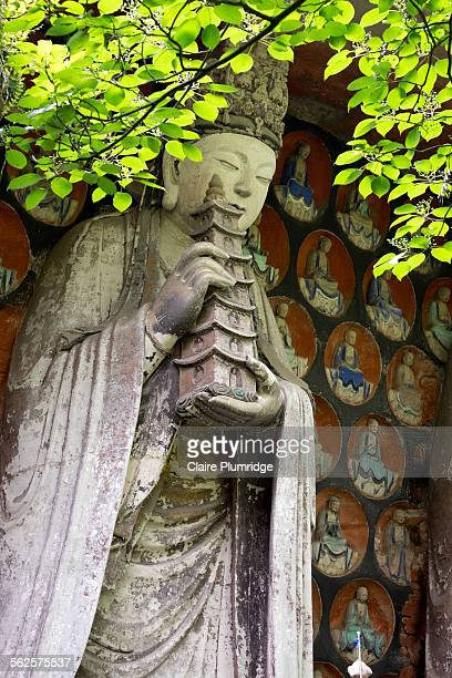 rock carvings, baodingshan, dazu, china - dazu rock carvings stock photos and pictures