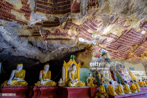 Rock carvings on the ceiling and Buddha statues at Kawgoon cave also known as Kawgun Cave Temple or Cave of the Ten Thousand Buddhas