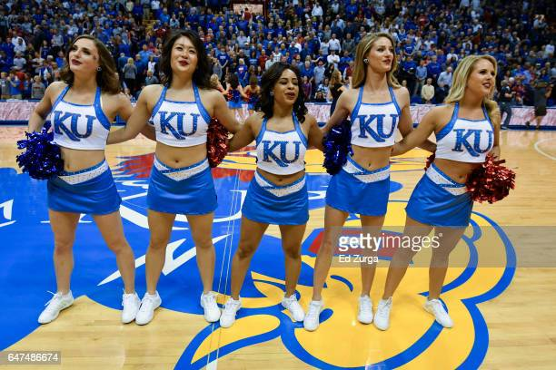 Rock Chalk Dancers entertain prior to a game between the Oklahoma Sooners and Kansas Jayhawks at Allen Fieldhouse on February 27 2017 in Lawrence...