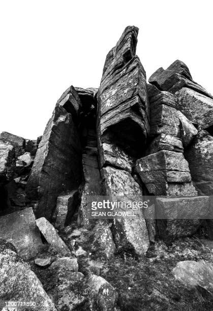 rock cliff black and white - rock stock pictures, royalty-free photos & images