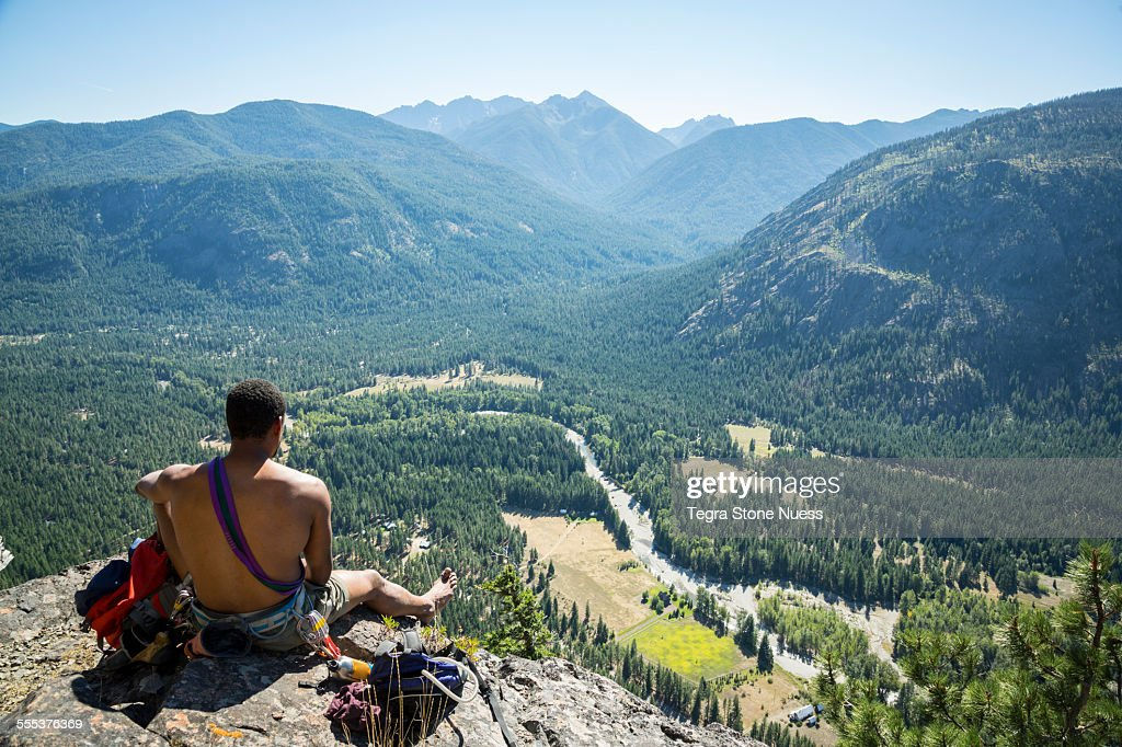 A rock climber at the summit : Stock Photo