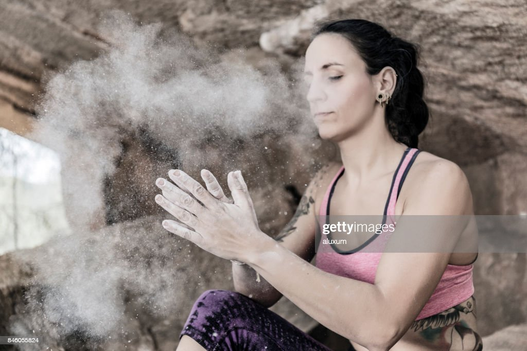Rock climber clapping hands with magnesium chalk : Stock Photo