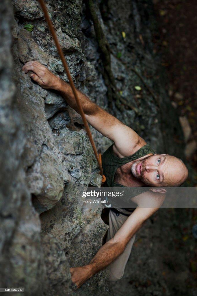 Rock climber climbing rock wall : Stock Photo
