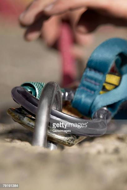 Rock climber concording a carabiner with a hook